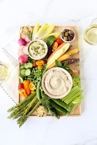 "<p>Spring Vegetable Crudit<span style=""font-size: 1em; background-color: transparent;"">é</span><span style=""font-size: 1em; background-color: transparent;"">s are served with White Bean Dip.</span></p>(Kristen Massad/Special Contributor)"