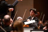 Cello soloist Daniel Müller-Schott performs with conductor Karina Canellakis and the Dallas Symphony Orchestra at the Meyerson Symphony Center in Dallas on May 9, 2019.(Allison Slomowitz/Special Contributor)