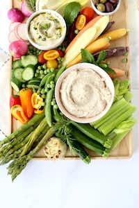 "<p><p>Spring Vegetable Crudit<span style=""font-size: 1em; background-color: transparent;"">é</span><span style=""background-color: transparent; font-size: 1em;"">s are served with White Bean Dip.</span></p></p>(Kristen Massad/Special Contributor)"