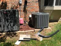 <p>Watchdog Dave Lieber took this photo of the conversion of his home's air conditioning unit from the old refrigerant to the new, more environmentally friendly one. The manufacture of Freon comes to a halt in January due to a federal mandate.</p>(Dave Lieber/Staff)