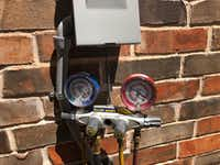 Watchdog Dave Lieber took this photo of the meter that measured the Freon leak at his house. It was 8 pounds — an environmental hazard and a tremendous waste of money to fill it up again.(Dave Lieber/Staff photo)
