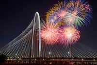 Fireworks exploded over the Margaret Hunt Hill Bridge during the Red, White, and Boom on the Bridge event July 3, 2018, in Dallas.(Smiley N. Pool/Staff Photographer)