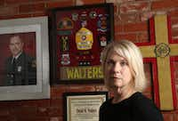 Kristi Walters, wife of Dallas firefighter David Walters who died suddenly last November, poses for a photograph at her home in Dallas on Friday, May 3, 2019. (Rose Baca/Staff Photographer)(Rose Baca/Staff Photographer)