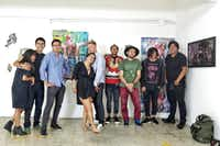 "In this 2018 photograph, artists Randall Garrett, who is participating in ""Pass the Peas"" is shown with a group of artists he organized from Mexico City for an event at his Plush Gallery in Dallas. From left to right: Yaudiel Jim nez, Salve C sar, Pablo Tonatiuh Alvarez Reyes, Alba Vida, Randall Garrett, Alan M ndez, Rom n Olayo Estrada, Brian Martinez, and Adri n Coss. (Randall Garrett)"