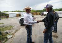 Special Ranger John Bradshaw (left) of the Texas and Southwestern Cattle Raisers Association shakes hands with Kyle Anderson after Bradshaw got his story about what happened when he found stray cattle on a neighbor's land in Decatur, Texas on Thursday, May 2, 2019.(Vernon Bryant/Staff Photographer)
