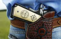 Detail of the pistol grip of Special Ranger John Bradshaw of the Texas and Southwestern Cattle Raisers Association.(Vernon Bryant/Staff Photographer)