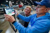 Deane Sage of Louisville, Ky., and his wife, Cathy, got an early look at the HistoPad at the National Museum of the U.S. Air Force in Dayton, Ohio.(John Minchillo/The Associated Press)