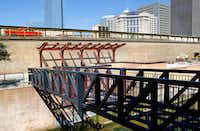 Crews worked last month on a new pedestrian bridge, stairway and shade structures being built at the north end of the Bricktown Canal in Oklahoma City. The popular destination will mark its 20th anniversary this summer. (Jim Beckel/The Oklahoman)