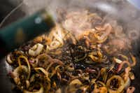 Caramelized onions are doused with balsamic vinegar.(Ryan Michalesko/Staff Photographer)