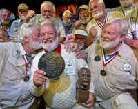 """Charlie Boice (center) was congratulated by previous victors  after winning the 2015 Ernest """"Papa"""" Hemingway look-alike contest at Sloppy Joe's Bar in Key West, Fla. The competition is part of the island's annual Hemingway Days festival, which this year will be July 16-21.(2015 File Photo/The Associated Press)"""