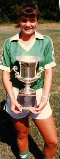 "<p><span style=""font-size: 1em; background-color: transparent;"">Laura Anton poses with the team's trophy after the D'Feeters Soccer Club won a regional championship in North Carolina in June 1983.</span></p>(Special to The Dallas Morning News)"