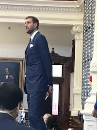 "<p>Mavericks legend Dirk Nowitzki stands before the Texas House on Tuesday. It was the basketball legend's first trip to Austin.  <span style=""font-size: 1em; background-color: transparent;"">""It's really nice,"" he said. ""The traffic wasn't too bad either.""</span></p>(Gardner Selby/Staff)"