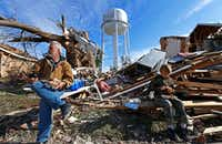 Homeowner Gary Hale (left) took a lunch break with his grandson Gabriel Hale while cleaning up at his house,  which was leveled by a tornado in Rowlett on Dec. 26, 2015. (Jae S. Lee/Staff Photographer)