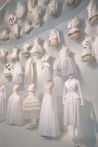 "The ""Office of Dreams"" area of the Dior exhibition shows the white toiles that fashion designers use to sketch out new ideas.  (Tom Fox/Staff Photographer)"