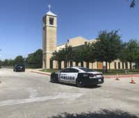 A Dallas Police vehicle outside St. Cecilia Catholic Church in Dallas on Wednesday. Dallas police officers raided several Dallas Catholic Diocese offices after a detective said church officials have not cooperated with investigations into sexual abuse by its past clergy members.(Dave Tarrant/Staff)