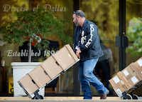Dallas police cart out boxes from a raid on the Catholic Diocese of Dallas on Wednesday. Dallas police officers  raided several Dallas Catholic Diocese offices after a detective said church officials have not cooperated with investigations into sexual abuse by its past clergy members.(Tom Fox/Staff Photographer)