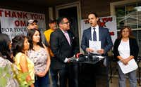 HMK landlord Khraish Khraish (second from right) announced at a press conference that he'd changed his mind and would  to sell homes to their West Dallas tenants for $65,000 in  May 2017. (File Photo/Tom Fox)
