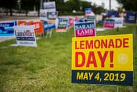 Although unrelated to the election -- aside from election day and Lemonade Day both being on May 4, 2019 -- a sign for Lemonade Day is displayed among campaign signs near Our Redeemer Lutheran Church, an early voting polling place, on Monday, April 29, 2019 in Dallas. (Ashley Landis/Staff Photographer)