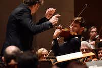 """<p>Violinist Blake Pouliot (right) and conductor Pablo Heras-Casado warmly shaped the<span style=""""font-size: 1em; background-color: transparent;"""">Brahms Violin Concerto's more melodic parts and daringly stretched major transitions without overdoing them.</span></p>(Ben Torres/Special Contributor)"""