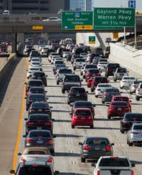Gridlock is routine on the Dallas North Tollway in Plano. Once it was crowded in one direction, but now the road is congested both ways day and night.(Smiley N. Pool/Staff Photographer)