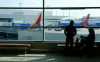 Lorenza Bowen (left) and Uyvonnie Ford wait for their flight at Dallas Love Field Airport on April 23, 2018. Behind them are Southwest Airlines planes at the gates. (Nathan Hunsinger/The Dallas Morning News)(Nathan Hunsinger/Staff Photographer)