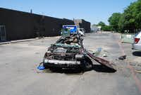 The stolen car was totaled after the driver lost control and the vehicle rolled a number of times.(Arlington Police Department)