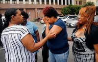 Shaquna Persley (center), mother of slain 13 yr-old Shavon Randle, is comforted by family as she leaves the Earle Cabell Federal Building in Dallas following the sentencing of Darrius Fields, Friday, May 17, 2019. Darius Fields was given an 18 year sentence by Judge Barbara Lynn on firearms charges, including the illegal possession of a weapon. He's believed to be connected to the death of Randle.(Tom Fox/Staff Photographer)