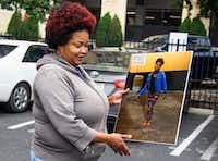 Shaquna Persley holds a picture of her daughter, Shavon Randle, as she exits the Earle Cabell Federal Building in Dallas on Tuesday, April 23, 2019. Darius Fields was given 18 years in prison for firearms offenses.  But prosecutors say he had Shavon killed over a drug robbery she had nothing to do with.(Shaban Athuman/Staff Photographer)