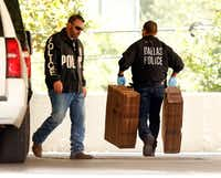 """Dallas police officials carry cardboard boxes into the Catholic Diocese of Dallas as they continued to gather evidence, Wednesday, May 15, 2019. Dallas police on Wednesday morning raided several Dallas Catholic Diocese offices after a detective said church officials have """"thwarted"""" his investigations into allegations of sexual abuse by priests. Dallas Bishop Edward J. Burns said at an afternoon news conference that the diocese had given personnel files """"for all the priests named in the warrant"""" and had been has been cooperating with the police requests. (Tom Fox/The Dallas Morning News)(Tom Fox/Staff Photographer)"""