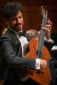 """<p>Guitarist Pablo&nbsp;<span style=""""font-size: 1em; background-color: transparent;"""">Sáinz&nbsp;</span><span style=""""font-size: 1em; background-color: transparent;"""">Villegas performs with the Fort Worth Symphony Orchestra at Bass Performance Hall in Fort Worth, Texas on May 17, 2019.&nbsp;</span></p>(Robert W. Hart/Special Contributor)"""