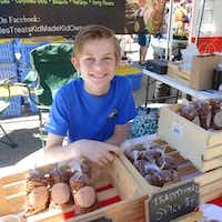 Charlie Kobdish was on hand at the Lakewood Village Farmers Market kick-off with kid-made Charlie's Treats flavored pecans.(Kim Pierce)