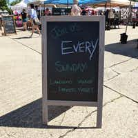 A sign last Sunday reminded shoppers to come back and visit Dallas'  newest farmers market, at Lakewood Village in East Dallas.(Kim Pierce)