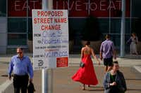 A sign at Olive Street and Victory Park Lane gives notice of a proposed renaming of Olive Street in honor of Dirk Nowitzki on Monday, May 20, 2019, in Dallas. (Smiley N. Pool/The Dallas Morning News)(Smiley N. Pool/Staff Photographer)