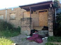 <p>The former home of Station 44 in South Dallas is now a place where homeless people sleep. But soon it could be back in private hands. (Robert Wilonsky/Staff)</p>