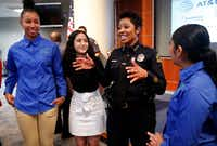 Dallas Police Chief U. Renee Hall visited Tuesday with Youth Commission representatives (from left) Francesca Jennings, Fernanda Aguero and Judith Gonzalez after the launch of DPD to YOU(TH) summer jobs program, for teens from some underserved communities. Up to 50 students will intern in police substations in their communities this summer. (Tom Fox/Staff Photographer)