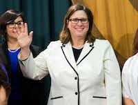 "<p><span style=""font-size: 1em; background-color: transparent;"">Rep. Julie Johnson, a Carrollton freshman shown at a January press conference, is among 20 House Democrats who provided crucial votes for a constitutional amendment that would more deeply discourage anyone pushing a state income tax.</span></p>(Ashley Landis/Staff Photographer)"