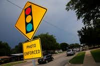 A sign warned drivers of the city of Irving's use of red light cameras at O'Connor Road and Lane Street in 2018. (Tom Fox/Staff Photographer)