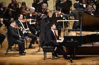 Alim Beisembayev of Kazakhstan plays Tchaikovsky's Piano Concerto No.1 in B-flat Minor, op. 23 with conductor Mei-Ann Chen and the Fort Worth Symphony Orchestra during the first  Cliburn International Junior Piano Competition and Festival at Ed Landreth Auditorium in Fort Worth on June 28, 2015.(File Photo/Staff)