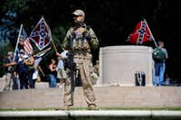 A Texas Liberty Coalition security person stood guard over This Is Texas Freedom Force protest in September 2017 after the Robert E. Lee statue was removed from the now-former Lee Park.(Tom Fox/Staff Photographer)