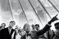Architect I.M. Pei, who designed the Morton H. Meyerson Symphony Center, calls attention to details as he leads a media tour  of the new hall in September 1989. More than 200 journalists, many of them foreign music and architecture critics, were visiting.(David Leeson/Staff photographer)