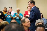 "Dallas Mayor Mike Rawlings is applauded by people in the crowd after he received a proclamation from the DISD board of trustees declaring him the ""Education Mayor.""(Smiley N. Pool/Staff Photographer)"