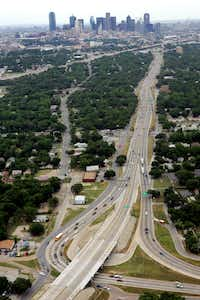 """""""Dead Man's Corner"""" (or Dead Man's Curve) on U.S. 175 is where C.F. Hawn Freeway (bottom, far right) curved sharply to become S.M. Wright Freeway (vertical line going north towards Dallas), which later connects to Interstate 45 (angle across top of the photo). The area has been under construction for several years.(Staff Photographer/The Dallas Morning News)"""