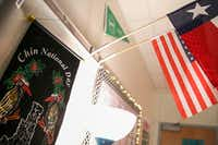 A Chin National Day banner hangs below the United States and Texas flags in a classroom during a meeting of the Chin Club at Lewisville High School Killough Campus on Tuesday, May 21, in Lewisville.(Ryan Michalesko/Staff Photographer)