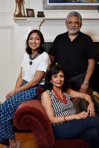 Food writer Priya Krishna, left, with her father Shailendra Krishna, right, and mother Ritu Krishna, at Priya's family home in Dallas.(Ben Torres/Special Contributor)