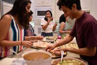 Food writer Priya Krishna, center, tastes a traditional Indian sauce while eating with family and their home in Dallas.(Ben Torres/Special Contributor)