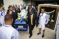 Pallbearers carry the casket of Muhlaysia Booker to a hearse Tuesday after a memorial service attended by hundreds of mourners. (Ashley Landis/Staff Photographer)