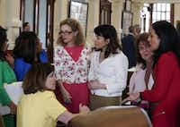From second from left, state Reps. Nicole Collier, Donna Howard and Gina Hinojosa, and Victoria Neave, right, all Democrats, plot strategy with other lawmakers on the House floor during a debate on Senate Bill 22 on Friday, May 17, 2019.(BOB DAEMMRICH/TNS)
