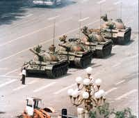 A Chinese man stands in front of a line of tanks in Beijing stopping their advance down Beijing's Cangan Blvd, near Tiananmen Square, on June 5, 1989.(JEFF WIDENER/AP)