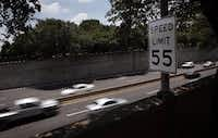 A speed limit sign says 55 mph on southbound Dallas North Tollway between Faifax Avenue and Edmondson Avenue in Highland Park.(Staff/The Dallas Morning News)