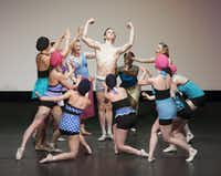 Dallas Neo-Classical Ballet company members surround dancer David Sanders during a dress rehearsal of <i>Le Train Bleu</i> at the Dallas Museum of Art in 2015. Departing artistic director Emilie Skinner often re-staged works originated by the Ballet Russes in the early 20th century.(Rex C. Curry/Special Contributor)